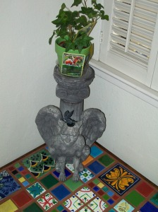 The gargoyle and his plant, decorated by Pokemon cards.